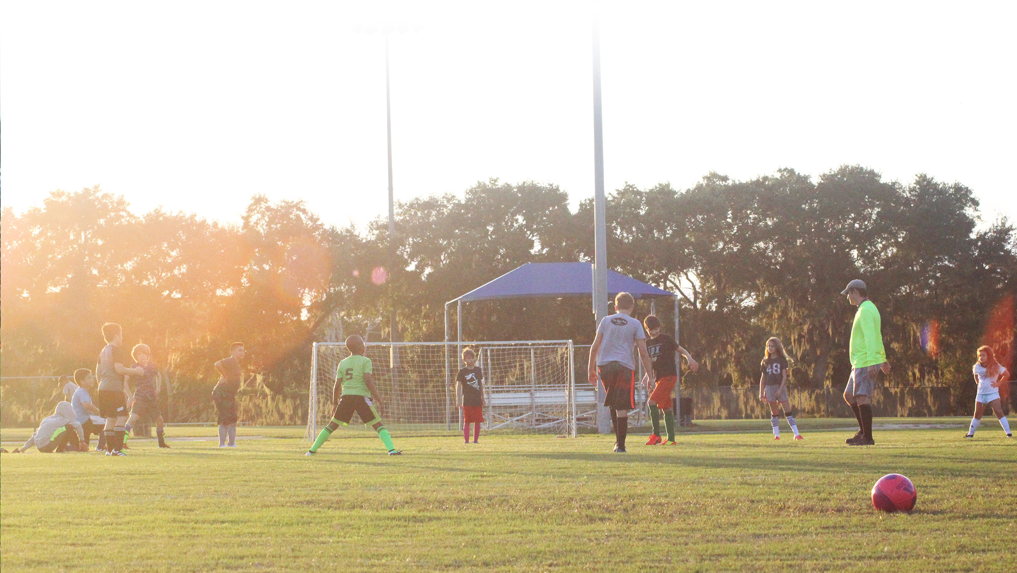 Youth soccer players warm up in St. Petersburg, Florida